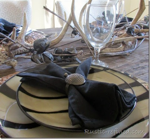 Rustic tablescape using antlers and animal print dishes