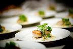 Roasted scallops with cauliflower, pineapple, capers, and coriander vinaigrette.