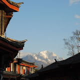 Lijiang - sunrise on mountains from the streets