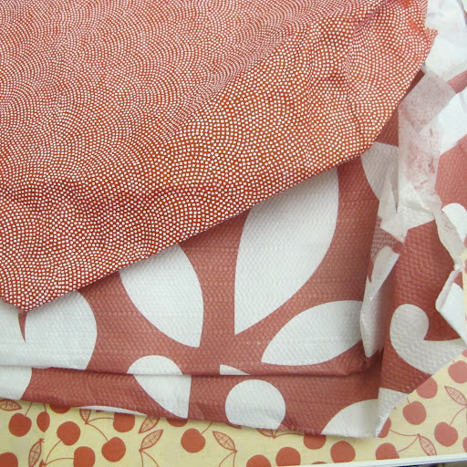 These are vintage fabrics and papers. I love these colors and patterns.