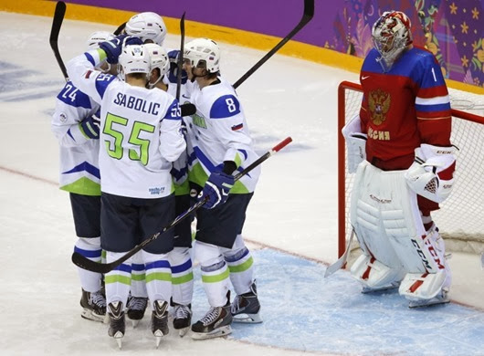 Russia goaltender Semyon Varlamov reacts as team Slovenia celebrates a second period goal during a men's ice hockey game at the 2014 Winter Olympics, Thursday, Feb. 13, 2014, in Sochi, Russia. (AP Photo/Mark Humphrey) ORG XMIT: OLYMH155