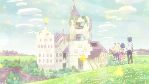 Three main characters stand on a clover-covered hillside with their backs to the viewer, looking out at the grand castle in the distance