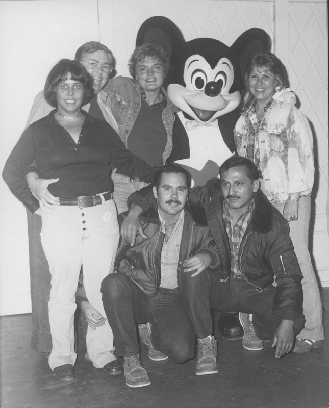 Gays and lesbians pose with Mickey at Gay Night at Disneyland. 1978.