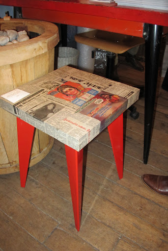 A decoupaged table-top with the chicest legs ever.