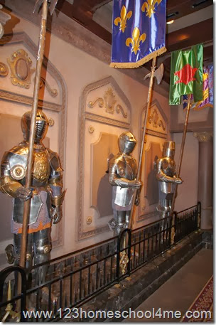 Whispering suits of armor in Be Our Guest Restaurant