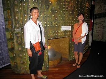 Becky and Pat next to a mockup of the Miraflores lock gate.