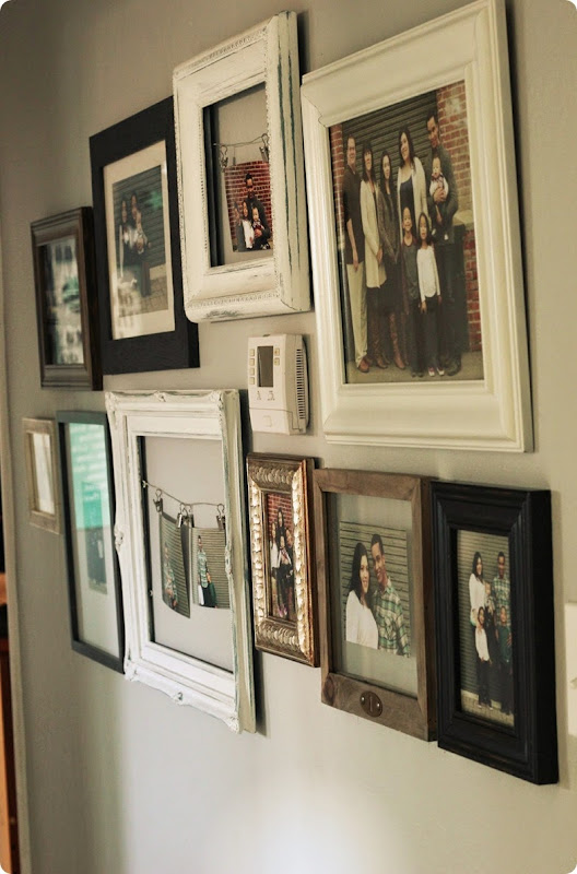 gallery wall with eclectic frames and family photos from alwaysinwonder