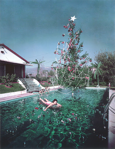 A dip in the pool at Christmas warrants a spectacular tree and floating ornaments. Rita Aarons (Slim's wife) in Hollywood, California, at Christmastime, 1954. (Poolside With Slim Aarons, Abrams)