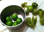 Start by removing the tomatillo husks and putting them in a pan with a jalapeño (which I left out because I was cooking for kids).