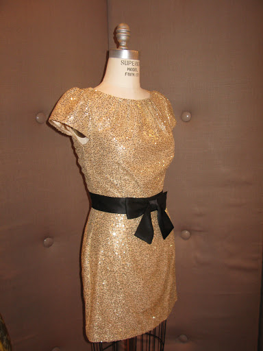 Sequin dress with black sash from Millie.