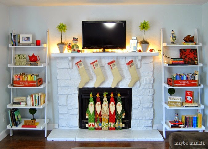 Stone fireplace painted white, dressed up for Christmas.