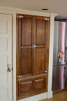 Here is the pantry I built. Solid walnut, with commercial grade hardware, to give it an old-time ice box feel.