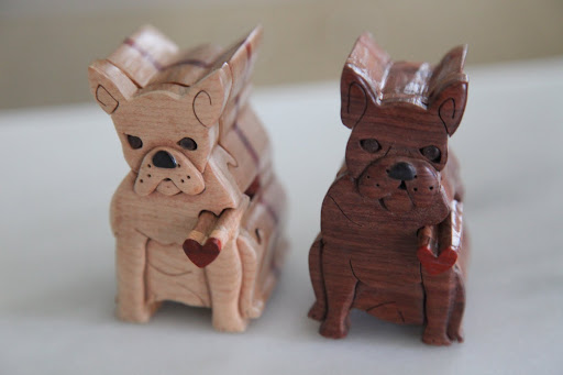 Well would you look at this, Francesca!  These wooden figures look just like us!  They're carved so nicely.