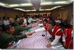 Karen and Burmese government ceasefire handshake