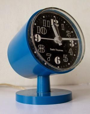 Blue Seth Thomas cylinder alarm clock