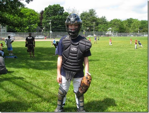 boy baseball catcher's gear