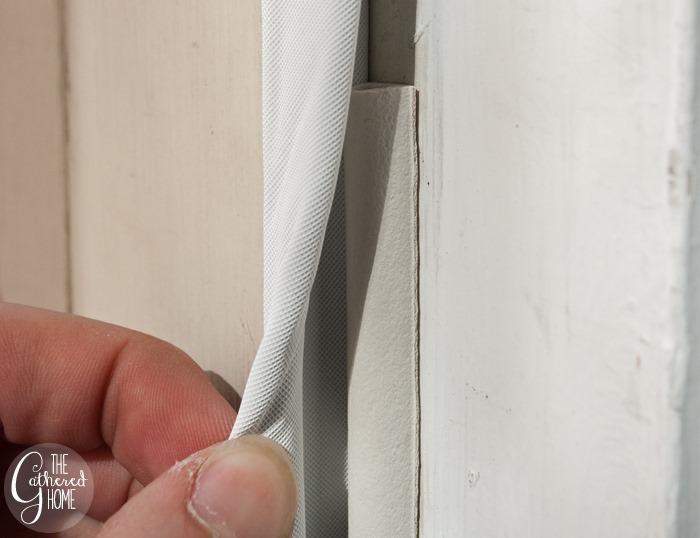 Tuck rubber weatherstrip behind kerf door set2