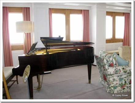 The baby grand piano in the family room which many members of the royal family played.