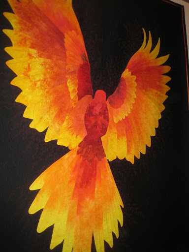 Phoenix Rising by Ferret. Hand dyed cotton sateen raw edge applique, constructed directly on longarm system. After a very bad year quilting gave me hope to follow the phoenix.