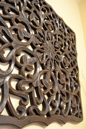 intricate detail on wood wall art