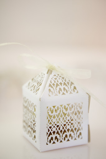 Mini cupcake favors in pretty boxes.