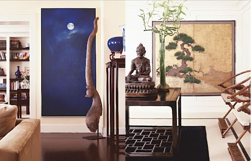 Nautica founder David Chu, now owner of David Chu Bespoke, owns a Mongolian rug to protect a limestone entrance and an antique Buddha next to lucky bamboo presides over the rest. Painting, left, is by Dutch artist Jan Grotenbreg and the wooden sculpture is from a Thai temple.