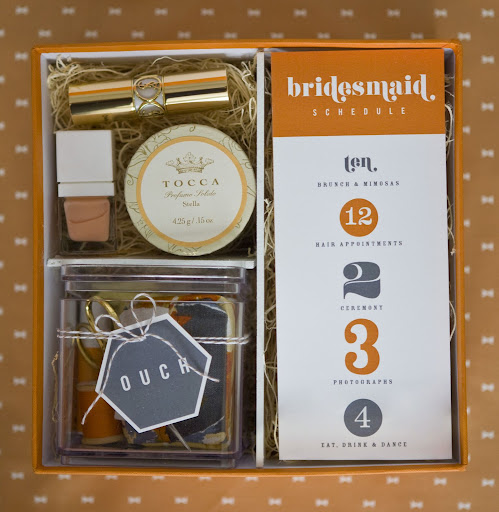 The box can hold all the bridesmaids' necessities for the day of the wedding: the itinerary, a first-aid and sewing kit, and beauty supplies.