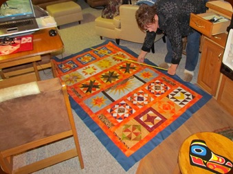 1302161 Feb 16 Barb Measuring Her Row Robin Quilt