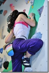 14832971-asian-girl-doing-bouldering-rock-climbing-on-a-high-rock-climbing-wall