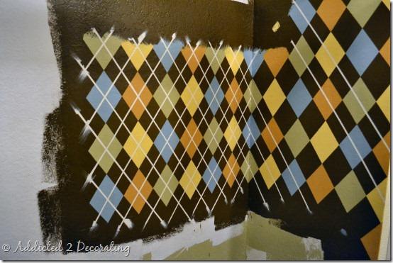 Repurposed closet--coat closet turned utility closet, argyle pattern painted on walls