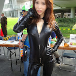 pretty girl in tidy leather in 40+ degrees at Comiket 84 - Tokyo Big Sight in Japan in Tokyo, Tokyo, Japan