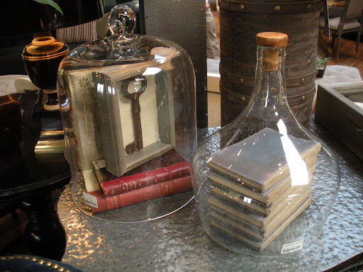 These glass covers can hold any number of decorative items. I love the dimpled metal surface they're resting on.
