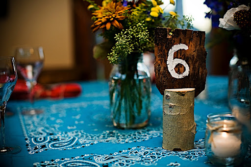 Rustic table numbers helped guests find their seats.