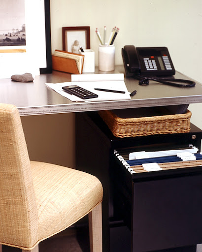 Metal filing cabinets are useful for files you need to have on hand at your desk.