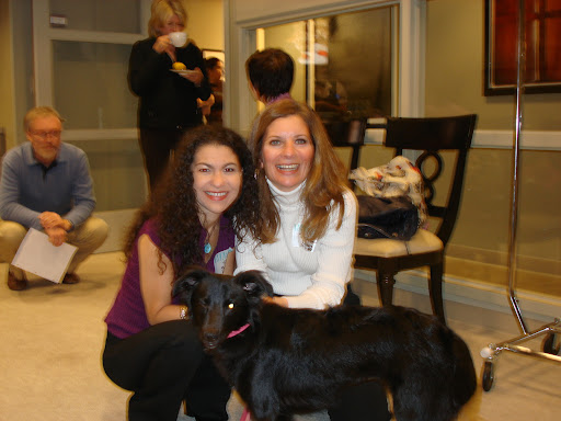 Kiara winks at the camera as Martha sips coffee and gets acquainted with all the dogs in the green room.