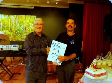 Club President, Gordon Sutherland, congratulating Acting Secretary, Peter Littlejohn, on his Birthday. All the members present were pleased to sign the Birthday Card. Photo courtesy of Colleen Kerr.
