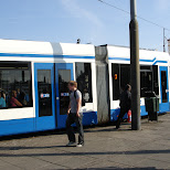 street cars near amsterdam central station in Amsterdam, Noord Holland, Netherlands