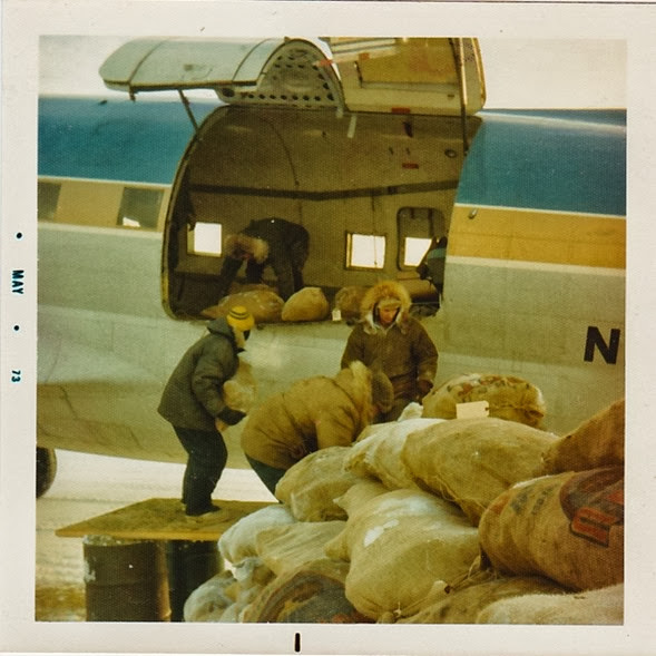 Loading C-46 w-fish bags_1973