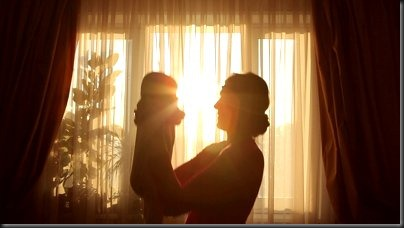 stock-footage-mother-plays-with-baby-before-window-in-silhouette
