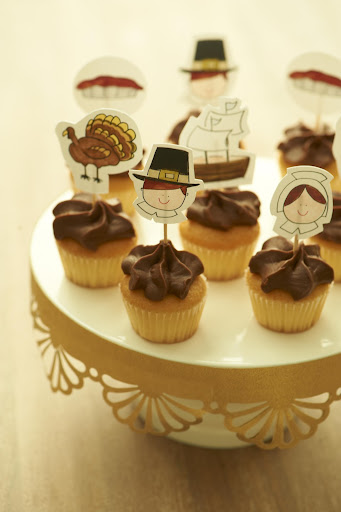 These cupcakes are decorated with my Thanksgiving artwork. Download them here: http://www.marthastewart.com/951490/darcy-millers-thanksgiving-ideas, then simply cut them out and tape them to toothpicks.