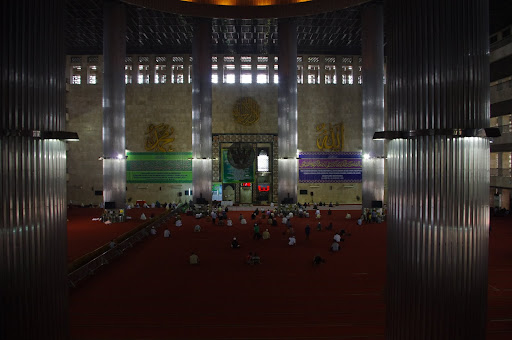 The grand domed prayer hall inside the enormous Istaqlal Mosque.