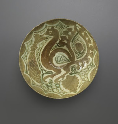 Deep bowl | Origin:  Iran | Period: 10th-11th century | Details:  Not Available | Type: Earthenware painted with slip under transparent glaze | Size: H: 7.6  W: 18.5  cm | Museum Code: F1966.27 | Photograph and description taken from Freer and the Sackler (Smithsonian) Museums.