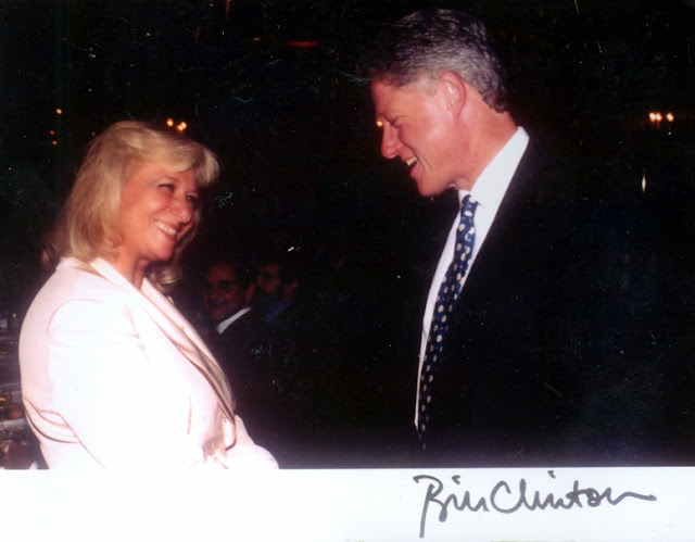 Loula with Bill Clinton with Clinton signature.jpg