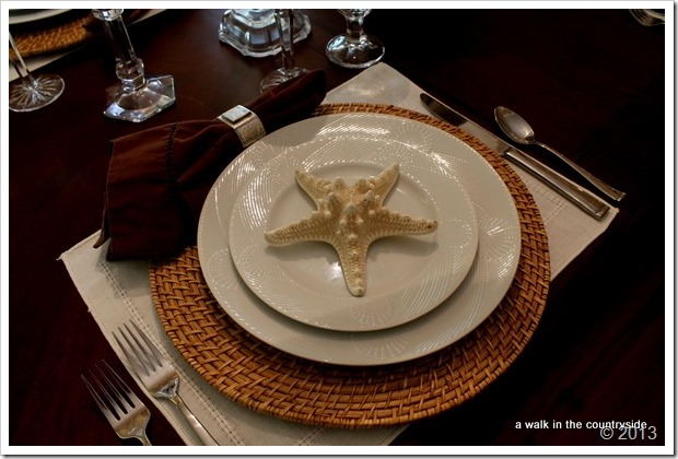 brown and white tablescape with shells