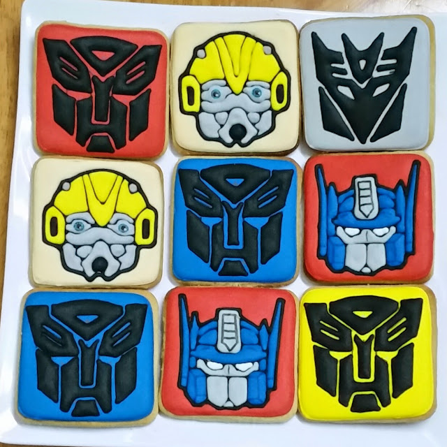 transformers cookies - decepticon logo, autobot logo, bumble bee and optimus prime