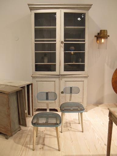 The juxtaposition of these chairs with this cabinet is what Jill does so well.