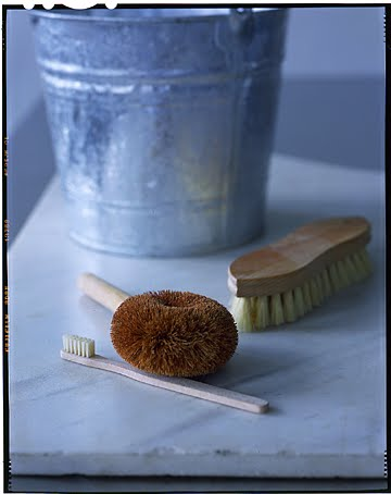 An old toothbrush is great for detailing and cleaning tight areas and scrub brushes come in a variety of  shapes and styles.  Choose ones that feel good in your hand.