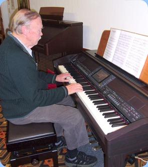 Colin Crann playing the arrival music on the Clavinova
