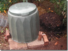 A Gedye Bin (left) produces rich fertile soil (right) from household scraps. The bin sits upon a brick base that prevents mice from tunneling up inside it looking for a free feed and a warm home.