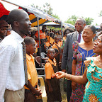 DSC_0318Naadu Mills Congratulating the Head Teacher of Kwao Larbi Anglican Primary Sch. Mr. Robert Acheampong..jpg